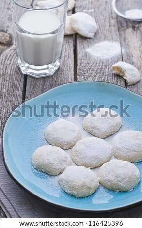 Mexican almond cookies with sugar on old style wood table