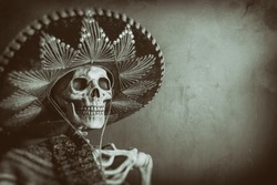 Mexican Bandit Skeleton 7. A skeleton wearing a Mexican sombrero and a poncho. Edited in a vintage film style.
