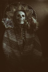 Mexican Bandit Skeleton 5. A skeleton wearing a Mexican sombrero and a poncho, with decorative flowers in a