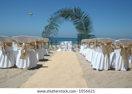 Mexican beach wedding with chairs alter and aisle