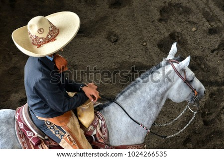Mexican charros mariachis horses horseback sombrero Mexico traditions ruedo racing culture festival rural equine holiday traditional outfit outdoors outfitters mexicano vaqueros sombreros band rider  #1024266535