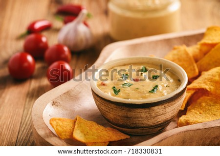 Mexican cheese dip served with nachos. #718330831