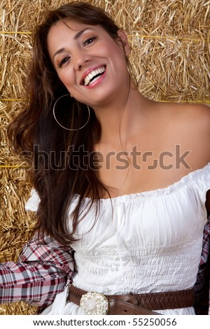 Mexican country girl in hay