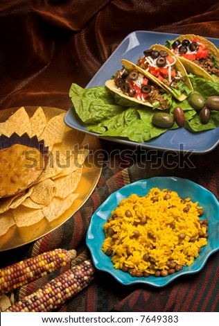 mexican dinner with tacos, rice and nachos