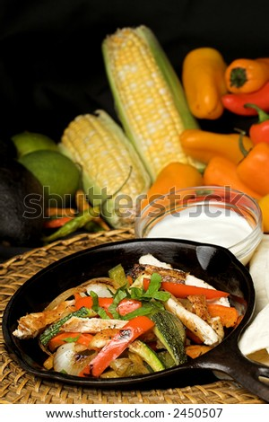 mexican fajitas in pan with typical ingredients