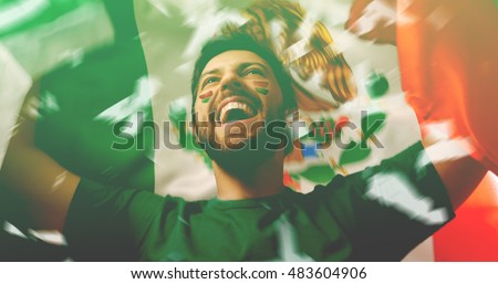 Mexican fan celebrates holding the flag of Mexico #483604906