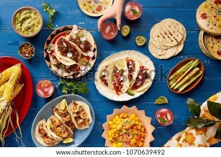 Mexican Feast Served Family Style - Shutterstock ID 1070639492