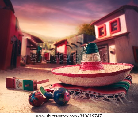 "Mexican fiesta background with a hat ""sombrero"" and ""maracas"" in a mexican town #310619747"