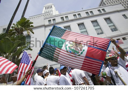 Mexican flag is superimposed over American flag in front of City Hall, protesting against Illegal Immigration reform by U.S. Congress, Los Angeles, CA, May 1, 2006