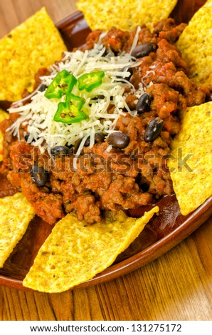 Mexican food: chili with meat and nachos
