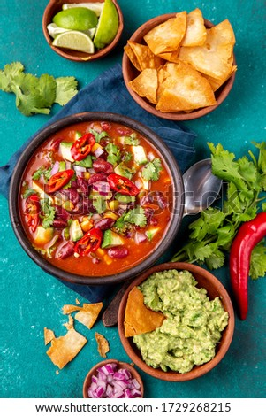 Mexican food concept background with chile black bean soup, guacamole and nachos totopos. Top view. Photo stock ©