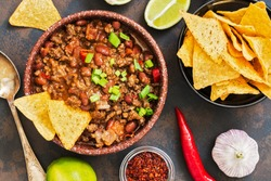 Mexican food dish chili con carne. The concept of Mexican cuisine. Top view, old, rusty background
