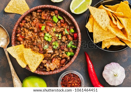 Mexican food dish chili con carne. The concept of Mexican cuisine. Top view, old, rusty background #1061464451