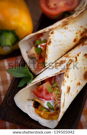 Mexican food. Fresh tortilla fajita wraps with chicken and vegetables