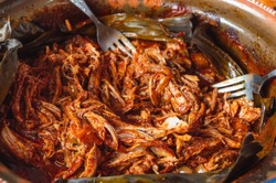 Mexican food. Preparing Cochinita Pibil, a Yucatecan pit-roasted pork dish, a fusion of Maya and European influences.