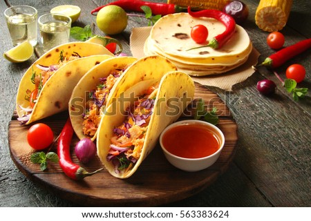 Mexican food tacos, fried chicken, greens, mango, avocado, pepper, red cabbage in tortillas #563383624