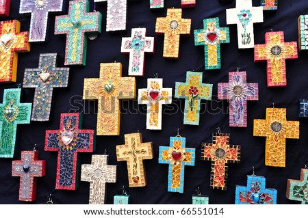 Mexican handcrafted christian crosses for sale at the art market in San Angel, Mexico City.