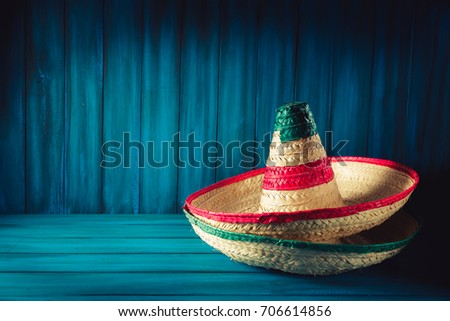 Mexican hats on a wooden background / High contrast image #706614856