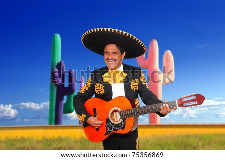 Mexican mariachi charro singing playing guitar in cactus background Mexico [Photo Illustration]