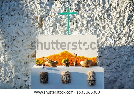 Mexican Mayan Day of the dead altar with mayan masks and cross, Merida, Mexcio #1533065300