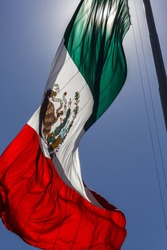 Mexican Monumental Flag flying over Mexico City Main Square