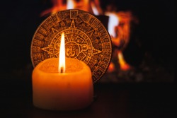 Mexican national emblem made of clay, mystical scene by candlelight that shows the union of the physical and spiritual worlds through unique symbols of the Aztec culture of pre-Hispanic times