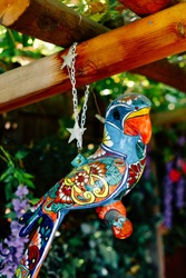 Mexican parrot sculpture. National Mexican pattern. Porcelain bird figurine.