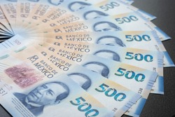 Mexican 500 pesos pile of blue bucks together
