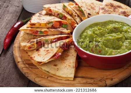Shutterstock Mexican quesadillas with cheese, vegetables and guacamole dipping sauce