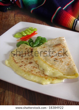 Mexican quesadillas with jalapenos and basil, in a mexican restaurant.