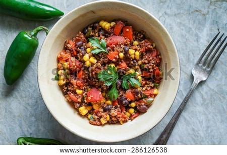 Mexican quinoa warm salad, chili, vegetarian food