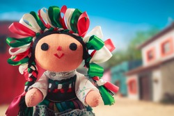 Mexican rag doll in a traditional dress on a mexican village