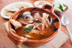 mexican seafood soup, cazuela de mariscos in Mexico is a bowl of spicy food with shrimps and fish