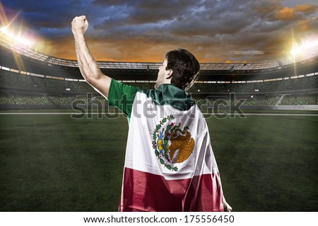 Mexican soccer player celebrating with the fans