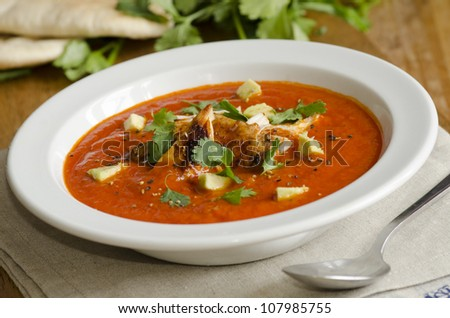 Mexican soup with chicken, avocado and coriander - stock photo