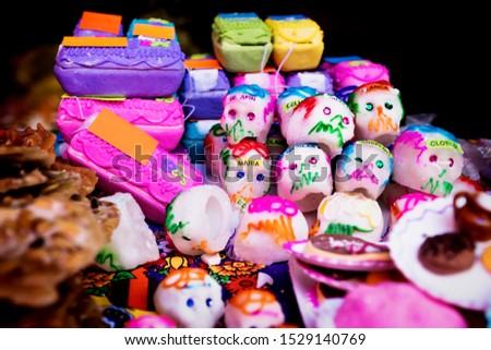 Mexican sugar skull and coffin candy, calaveras, traditionally used for dias de los muertos, halloween at the market of Merida, Mexico #1529140769