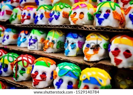 Mexican sugar skull candy with a bee, calaveras, traditionally used for dias de los muertos, halloween at the market of Merida, Mexico #1529140784