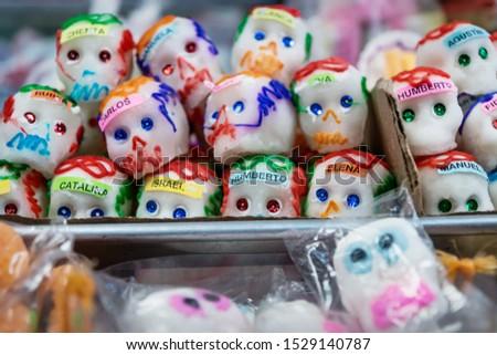Mexican sugar skull candy with names, calaveras, traditionally used for dias de los muertos, halloween at the market of Merida, Mexico #1529140787