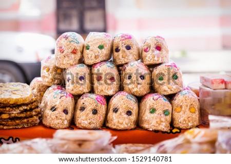 Mexican sugar skull candy with quinoa, calaveras, traditionally used for dias de los muertos, halloween at the market of Merida, Mexico #1529140781
