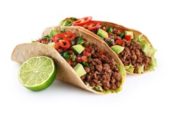 Mexican tacos with beef, tomatoes, avocado, chilli and onions isolated on white background. With clipping path.