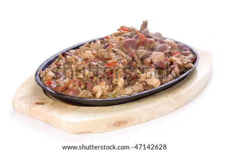 Mexican traditonal plate fajitas with beef, chicken and vegetables.