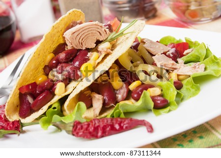 Mexican tuna salad with beans, pepper, lettuce and corn