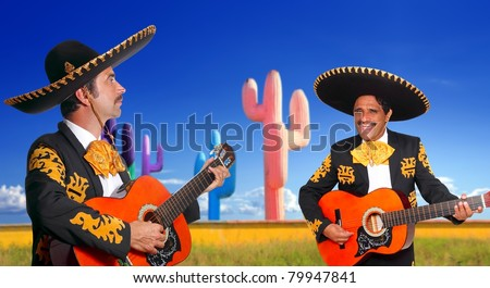 Mexican two mariachis with charro costume singing playing guitar in cactus Mexico [Photo Illustration]