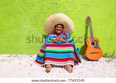 Mexican typical lazy topic man guitar poncho sit in green wall