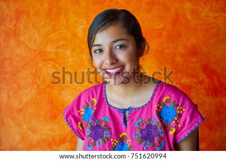 Mexican woman with mayan dress latin ethnicity on orange background #751620994