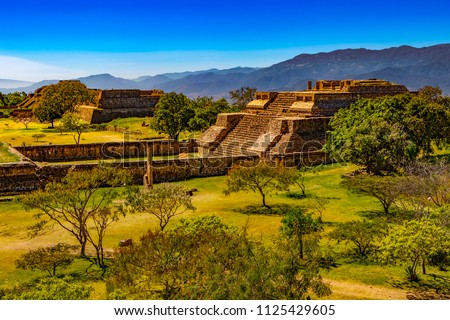 Mexico. Archaeological Site of Monte Alban (UNESCO World Heritage Site). Buildings on west side of the Grand Plaza - System IV (Building K) in the foreground