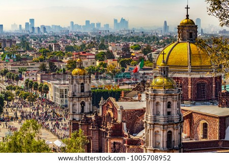 Mexico. Basilica of Our Lady of Guadalupe. Cupolas of the old basilica and cityscape of Mexico City on the far #1005708952