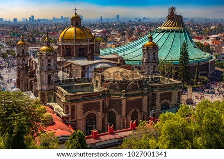 Mexico. Basilica of Our Lady of Guadalupe. The old and the new basilica (in the right), cityscape of Mexico City on the far