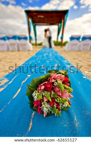 stock photo mexico beach wedding with bouquet in the foreground