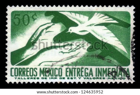 MEXICO - CIRCA 1969: A Stamp printed in Mexico shows hands of people who are ready to accept the white dove, circa 1969